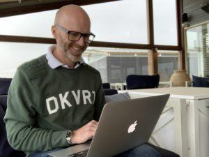 Ron behind laptop at beach bar